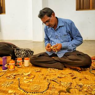 Odisha Tourists learn tribal jeweller making in Kala Bhoomi workshop