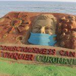 Coronavirus in  sand art on Puri beach