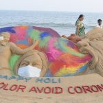 Sand art Holi message